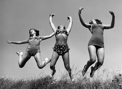 6. Three Windmill Theatre dancers enjoying the sun on the beach at Angmering during a break in rehearsals, 1952.
