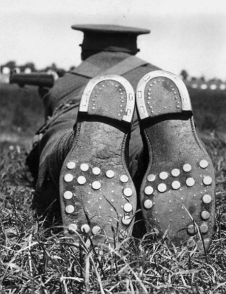 17. A soldier shooting in the Hopton Cup at Bisley shows his boots' steel studs, 1936.